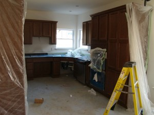 Kitchen with Whirlpool Appliances being installed